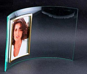Glass Photo Frame - Curved glass frame holds a 4X6 photo.