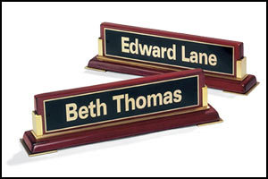 588 - Rosewood piano-finish nameplate with gold metal accents